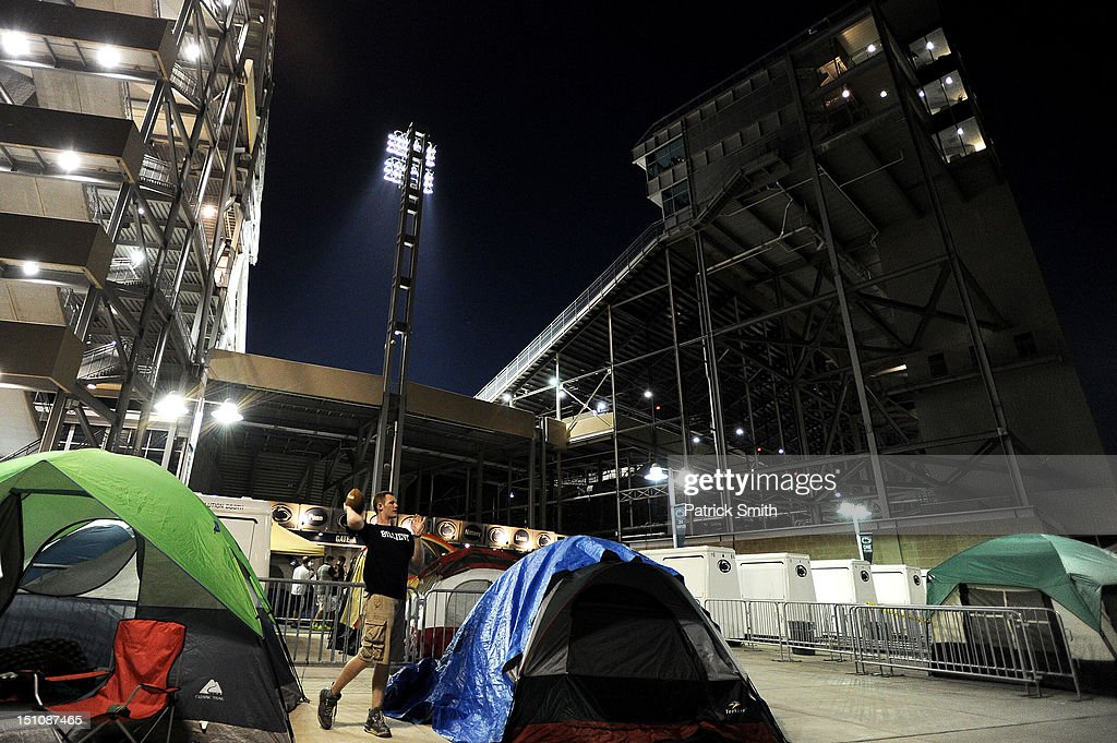 Nittanyville, where a group of students camp outside of Gate A at Beaver Stadium, toss a football after the Penn State Nittany Lions football team held a pep rally at Beaver Stadium on August 31, 2012 in State College, Pennsylvania. Penn State will play it's first game under new head coach Bill O'Brien against Ohio University on September 1 following the death of former coach Joe Paterno.