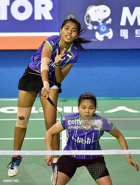 Nitya Krishinda Maheswari and Greysia Polii of Indonesia hit a return against Wang Xiaoli and Yu Yang of China during their women's doubles...