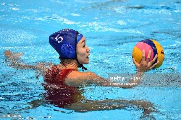 Niu Guannan of China in action during the Women's Water Polo Preliminary Round match between Japan and China in the Asian Games 2018 at Aquatic...