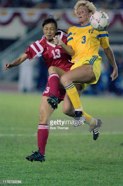 Niu Lijie of China and Anette Hansson of Sweden leap for the ball during play in the 1991 FIFA Women's World Cup quarter final match between China...