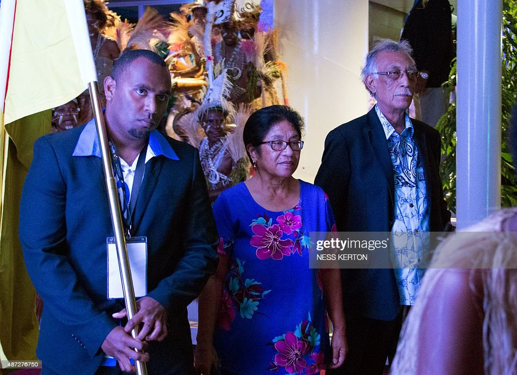 Niue Premier Toke Talagi (R) arrives for the official opening of the 46th Pacific Islands Forum (PIF) in Port Moresby on September 8, 2015. The 16-nation grouping consists mainly of small island nations, together with Australia and New Zealand, with the two developed nations being accused of dragging their feet on climate change. AFP PHOTO/Ness KERTON