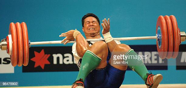 Niusila Opeloge of Samoa loses control of an attempted lift during the men's 105kg weightlifting event at the Melbourne Exhibition Centre during the...