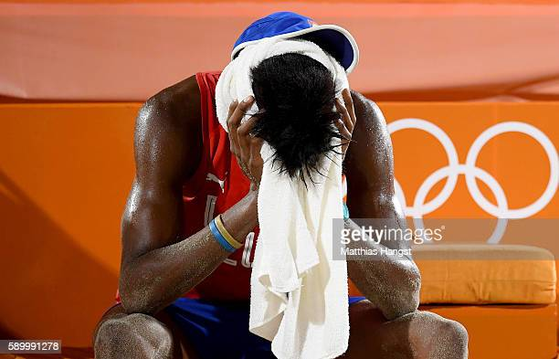 Nivaldo Nadhir Diaz Gomez sits dejected after losing the Men's Beach Volleyball Quarterfinal match between the Russia and Cuba on Day 10 of the Rio...