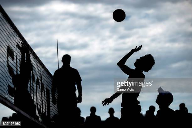 Nivaldo Nadir Diaz Gomez of Cuba spikes the ball during the match against Alvaro Magliano De Morais Filho and Saymon Barbosa Santos of Brazil at FIVB...
