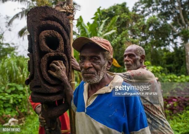 NiVanuatu statue carvers working in the forest on a fern tree Malampa Province Malekula Island Vanuatu on August 25 2007 in Malekula Island Vanuatu