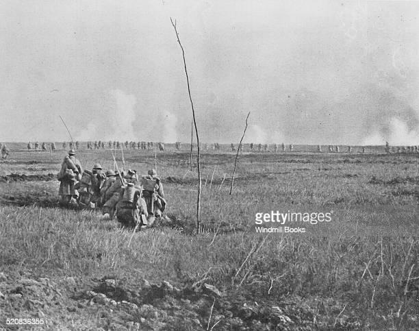 Nivelle Offensive 2nd wave of attack by 11 Colonial Corps advances in sections In the background the 1st wave has reached German trench on the Chemin...