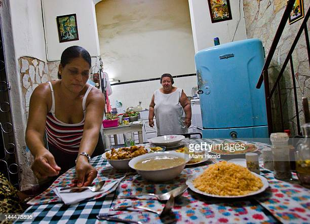 Nivia Melendez and her cook put dinner out for guests at her and her husband Roberto's Casa Colonial on Trinidad St on March 29 2012 in Santiago de...