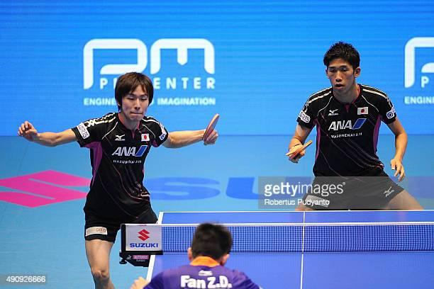 Niwa Koki and Yoshimura Maharu of Japan compete against Fan Zhendong and Xu Xin of China during Men's doubles semifinal match of the 22nd 2015 ITTF...