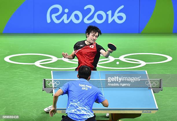 Niwa Koki of Japan competes against Tang Peng of Hong Kong during the Men's Table Tennis Singles Quarterfinal match 3 on Day 9 of the 2016 Rio...