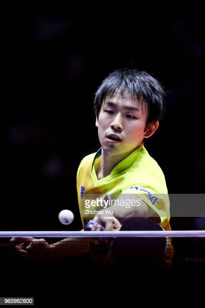 Niwa Koki of Japan in action at the men's singles quarterfinal compete with Fan Zhendong of China during the 2018 ITTF World Tour China Open on June...