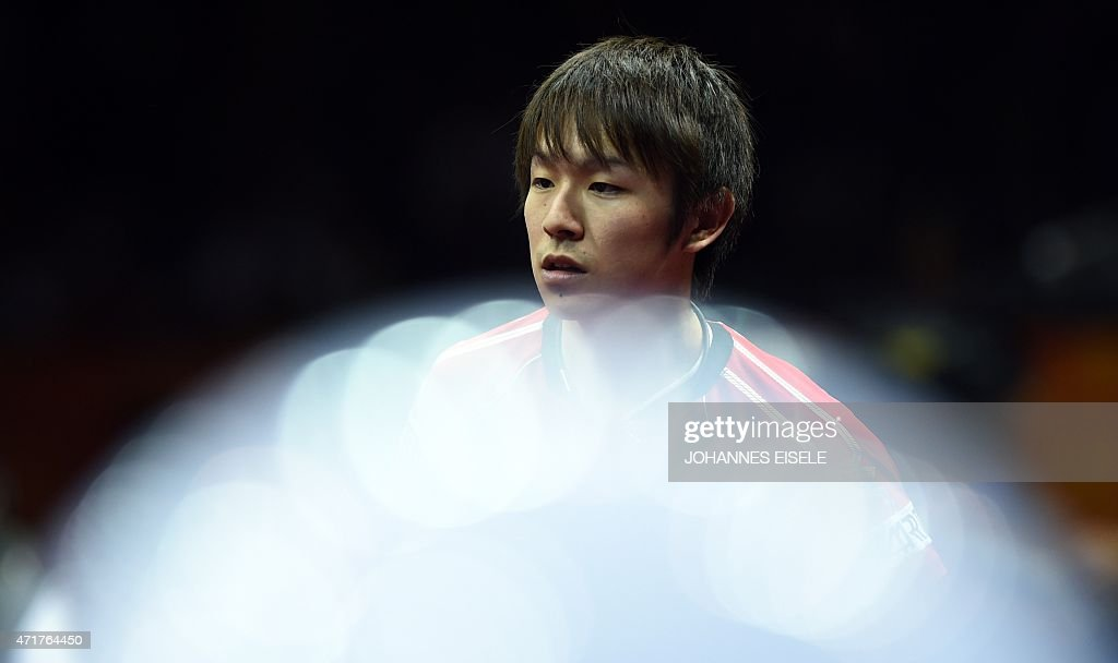Niwa Koki of Japanreacts during his men's singles match against Fan Zhendong of China at the 2015 World Table Tennis Championships at the Suzhou International Expo Center in Suzhou, Jiangsu province on May 1, 2015.