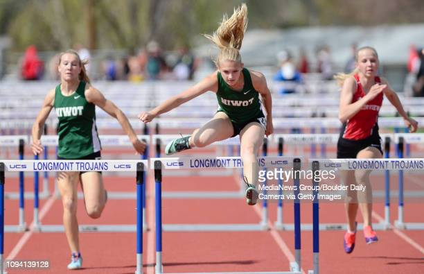 Niwot High School's Alexis Carroll center in the girls 100 meter hurdles during the Boulder County Track and Field Invitational on Thursday at...