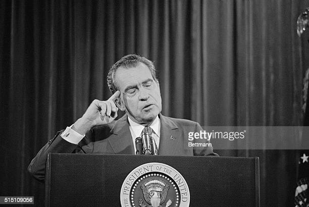 Nixon Addresses Conference. Disney World, Fla.: President Nixon shields the light from his eyes as he answers questions from managing editors at...