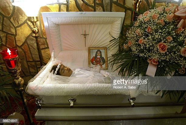 Nixzmary Brown's body lies in a casket at her wake at the Ortiz Funeral Home January 16 2006 in New York The abuse case is another in a string of...