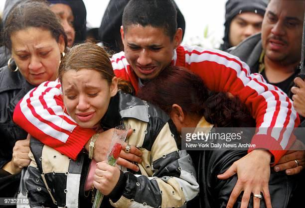 Nixzmary Brown's uncle Omar Santiago puts his arms around her cousin Jasmin Villanueva and her grandmother Maria Gonzalez as Nixzmary's casket is...