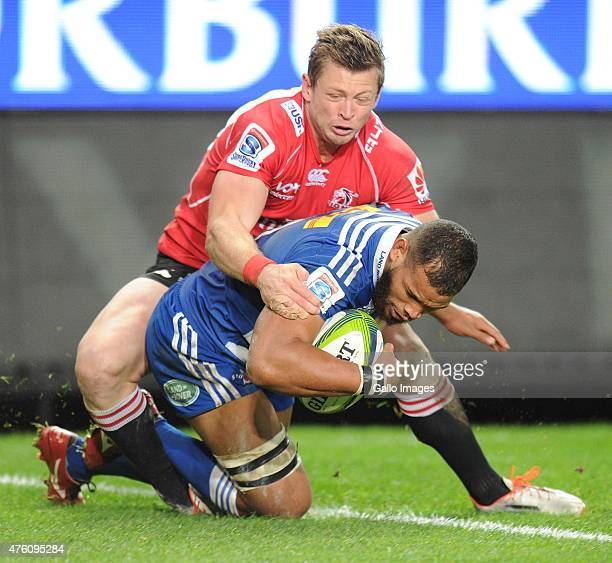 Nizaam Carr of the Stormers scores a try with Martin Muller of the Lions during the Super Rugby match between DHL Stormers and Emirates Lions at DHL...