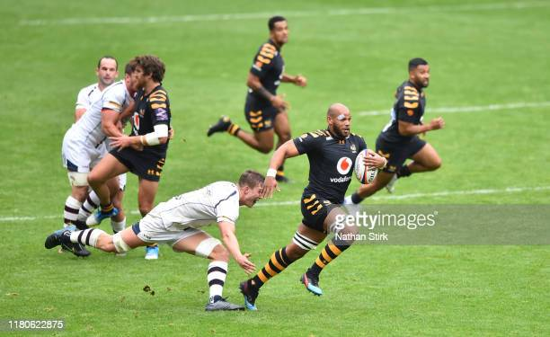 Nizaam Carr of Wasps drives forward during the Premiership Rugby Cup Fourth Round match between Wasps and Worcester Warriors at Ricoh Arena on...