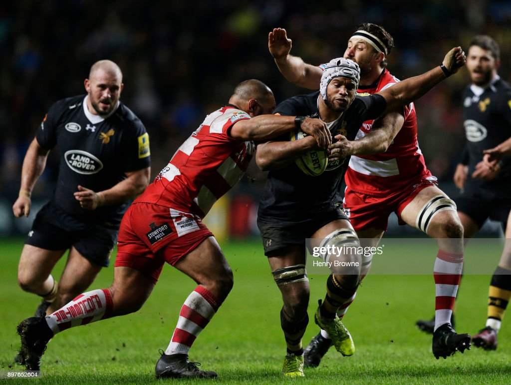 Nizaam Carr of Wasps tackled by John Afoa of Gloucester during the Aviva Premiership match between Wasps and Gloucester Rugby at The Ricoh Arena on December 23, 2017 in Coventry, England.