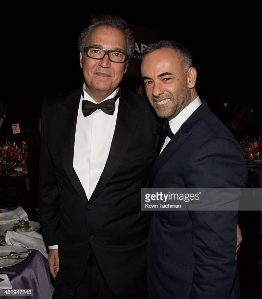 Nizan Guanaes left and Francisco Costa attend the 2014 amfAR's Inspiration Gala Sao Paulo on April 4 2014 in Sao Paulo Brazil