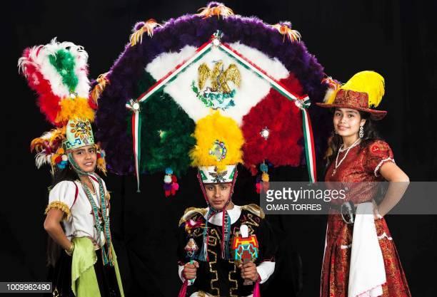 Nizarindani Ruiz Waldo Vazquez and Nayely Chacon from Villa de Zaachila pose during a rehearsal of the Feather Dance for the Guelaguetza traditional...