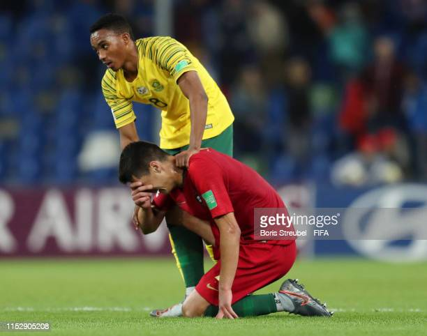 Njabulo Blom of South Africa consoles Diogo Leite of Portugal following their draw in the 2019 FIFA U-20 World Cup group F match between South Africa...