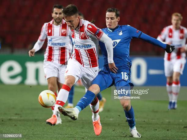 Njegos Petrovic of Crvena Zvezda in action against Sebastian Rudy of Hoffenheim during the UEFA Europa League Group L stage match between Crvena...