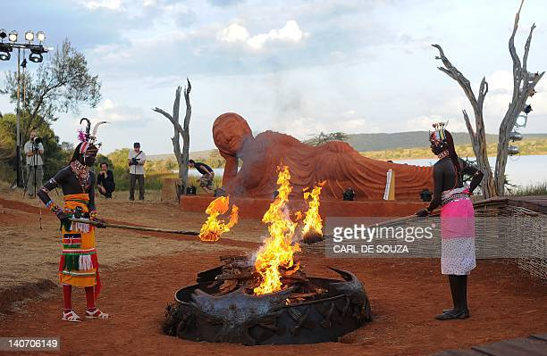 Njemps tribesmen light a ceremonial fire in front of a statue of Buddha at the Gallmann nature conservancy near Kinamba Laikipia Northern Kenya on...