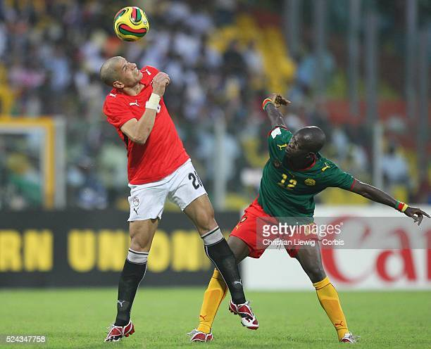 Nkong Alain of Cameroon and Gomaa Kamel Elhawty during the Final of the CAF African Cup of Nations played between Egypt and Cameroon in Accra, Ghana.