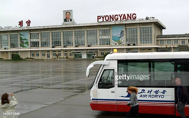NKoreapoliticssuccessionKimFEATURE by Ian Timberlake This photo taken on September 21 2010 shows a foreign visitor taking pictures of Pyongyang...
