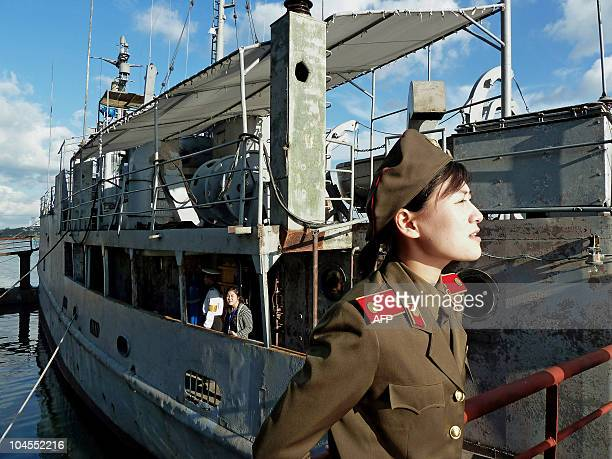 NKoreaUSmilitaryPuebloFEATURE by Ian Timberlake This photo taken on September 22 2010 shows a North Korean military female guide speaking to some...