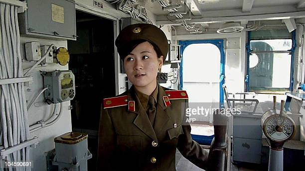 NKoreaUSmilitaryPuebloFEATURE by Ian Timberlake This photo taken on September 22 2010 shows a North Korean military female guide speaking to visitors...