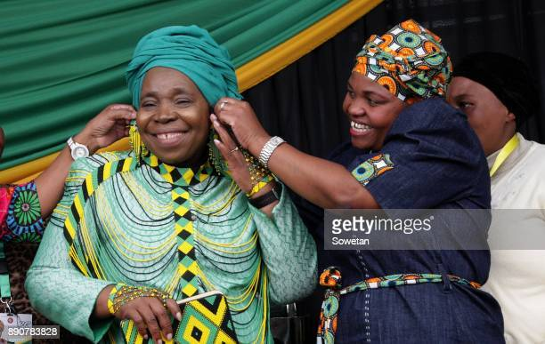 Nkosazana DlaminiZuma gets some help dressing from Phindile Dlamini during the prayer party organized by the Dlamini Clan in her home Bulwer on...