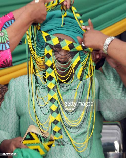 Nkosazana DlaminiZuma is adorned with beads during the prayer party organized by the Dlamini Clan in her home Bulwer on December 10 2017 in...