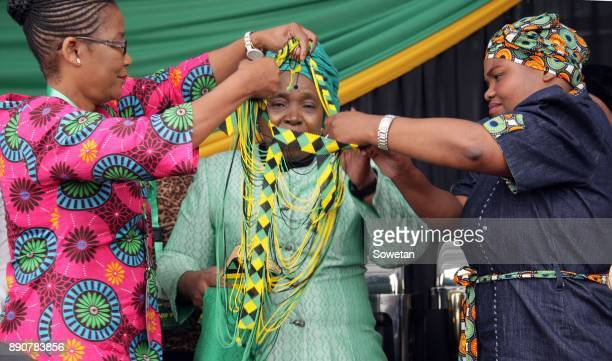 Nkosazana DlaminiZuma is being dressed in beads that resemble ANC colours during the prayer party organized by the Dlamini Clan in her home Bulwer on...