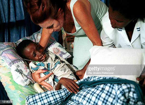 Nkosi Johnson age 12 cries out in his bed February 4 2001 at his home in Melville a suburb of Johannesburg South Africa as his adopted mother Gail...