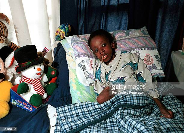 Nkosi Johnson age 12 rests his head on a pillow in his home February 4 2001 in Melville a suburb of Johannesburg South Africa Nkosi who was the...