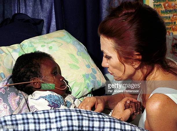 Nkosi Johnson age 12 rests his head on a pillow in his home February 4 2001 in Melville a suburb in Johannesburg South Africa as his adopted mother...