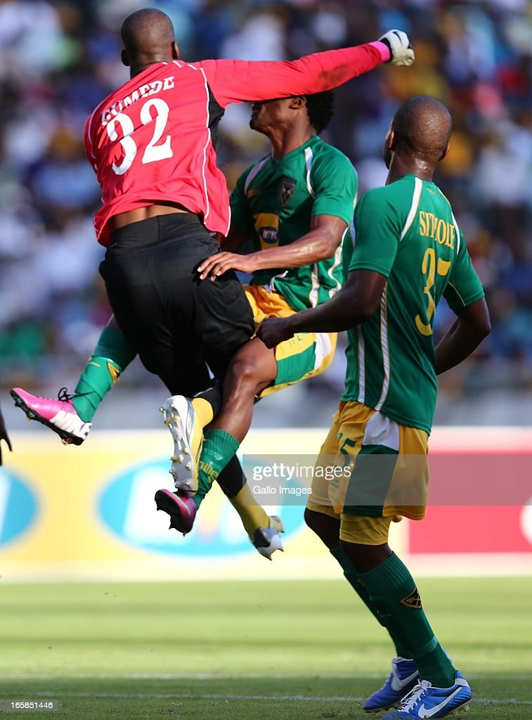 Nkosingiphile Gumede crashes into Mzivukile Tom during the Absa Premiership match between Golden Arrows and Kaizer Chiefs at Moses Mabhida Stadium on April 06, 2013 in Durban, South Africa.