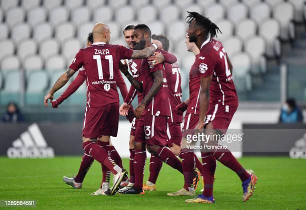 Nkoulou Nicolas of Torino FC celebrates with teammates Lyanco Vojnovic and Zaza Simone after scoring his team's first goal after scoring his team's...