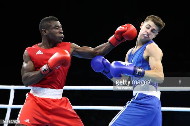 Nkumbu Silungwe of Zambia and Williams Edwards of Wales compete in the Mens Light Welter during Boxing on day four of the Gold Coast 2018...