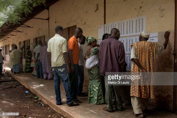 NMalian are seen at a pooling station as they checks the electoral list during the first round of the Presidential election on July 28, 2013 in...