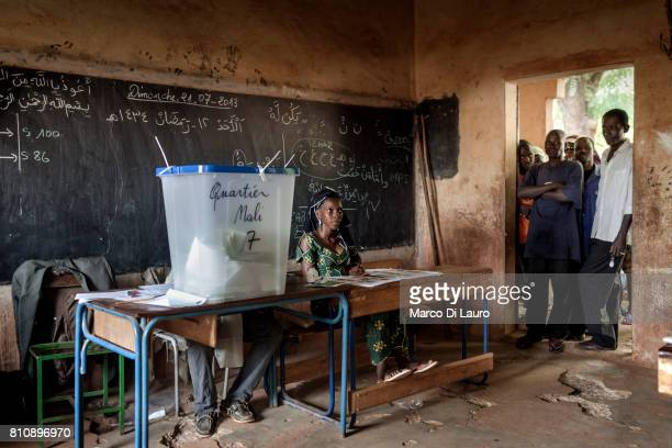 NMalian are seen at a pooling station as they wait to cast their ballots during the first round of the Presidential election on July 28, 2013 in...