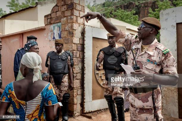 "NMalian police officers are seen guarding a pooling station during the first round of the Presidential election on July 28, 2013 in Bamako, Mali.""nIn..."
