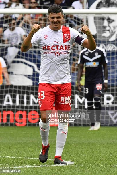 Nîmes' French defender Anthony Briancon celebrates after they scored during the French L1 football match between FC Girondins de Bordeaux and Nimes...