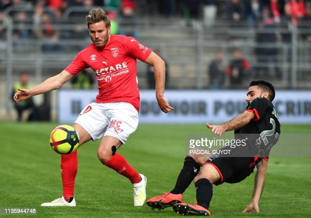 Nîmes' French forward Renaud Ripart fights for the ball with Rennes' French forward Romain Del Castillo during the French L1 football match between...