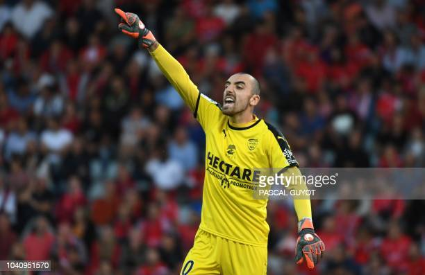 Nîmes' French goalkeeper Paul Bernardoni gestures during the French L1 football match between Nîmes and Guingamp, on september 26, 2018 at the...