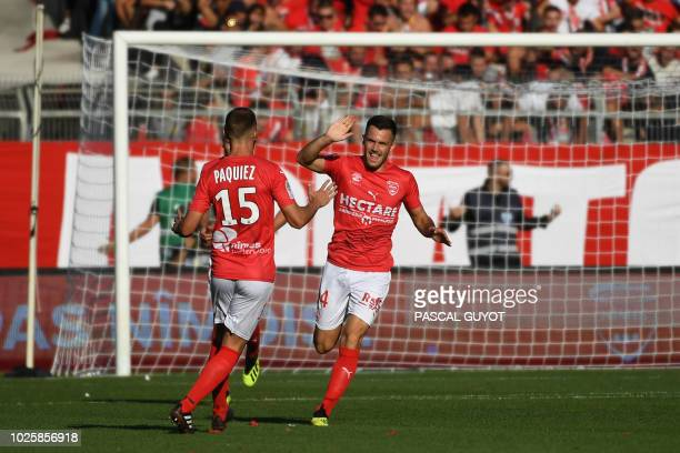 Nîmes' French midfielder Antonin Bobichon celebrates after scoring their first goal during the French L1 football match between Nimes and Paris...