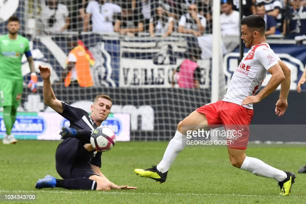 Nîmes' French midfielder Antonin Bobichon vies with Bordeaux's Danish midfielder Lukas Lerager during the French L1 football match between FC...