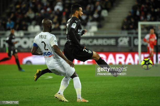 Nîmes' Moroccan forward Rachid Alioui fights for the ball with Amiens' French defender Prince Desir Gouano during the French L1 football match...