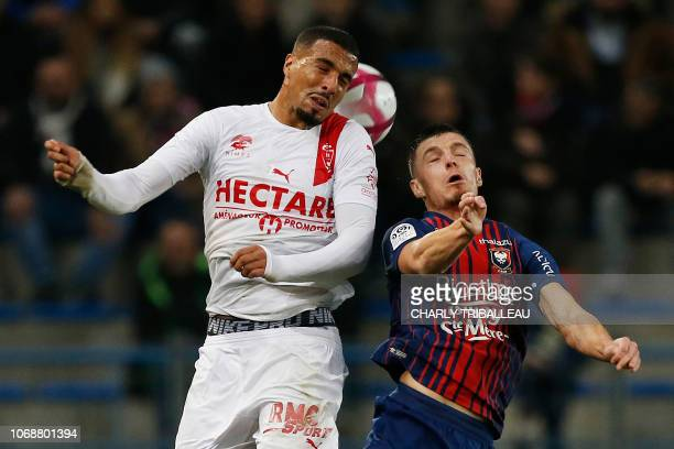 Nîmes' Moroccan forward Rachid Alioui vies for the ball with Caen's French defender Frederic Guilbert during the French L1 football match between...